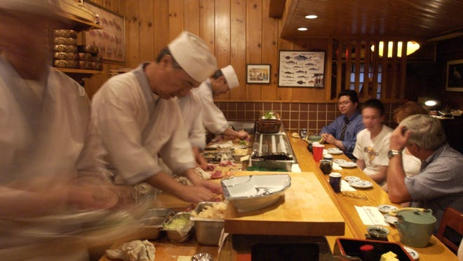 Chefs prepare sushi in unison at Sagami in Collingswood.