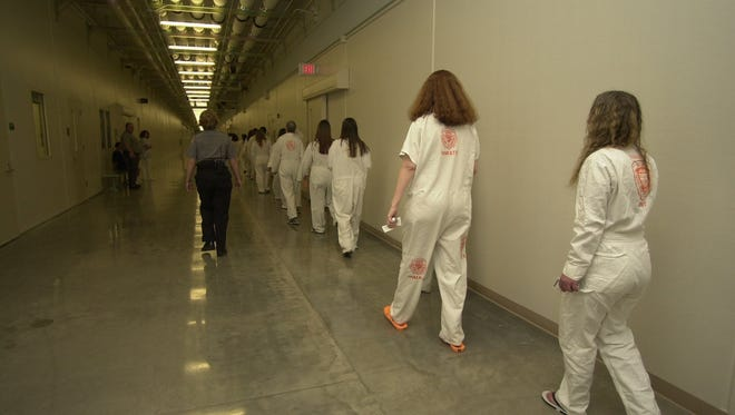 A corrections officer escorts inmates at Oregon Women's Correctional Center as they get ready to load a bus to their new home at the Coffee Creek Correctional Facility in Wilsonville on April 26, 2005. Rep. Carla Piluso, D-Gresham,said the female inmate population is expected to drop 8 percent by 2027.