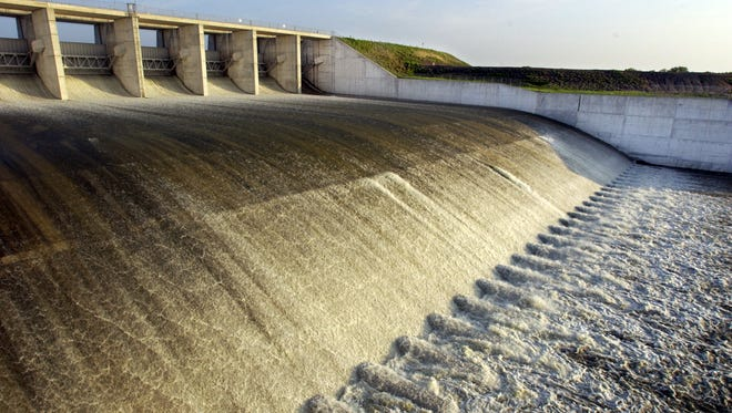 Floodwaters run through the spillway at Choke Canyon dam in July 2002.