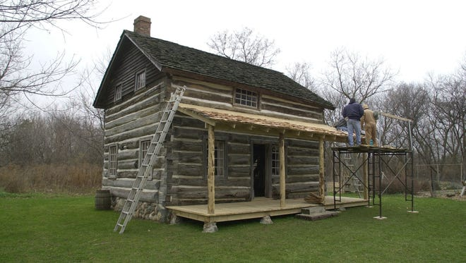Cabin projects are old hat in the Lansing area. The Darius Moon cabin at Woldumar Nature Center was remodeled by GM job bank workers in 2001.
