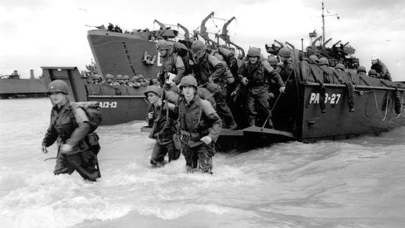 American reinforcements arrive on the beaches of Normandy from a Coast Guard landing barge on the French coast June 6, 1944 during World War II.