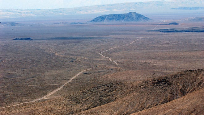 The top of Yucca Mountain, a proposed nuclear waste dump in Nevada, overlooks vast expanses of vacant land.