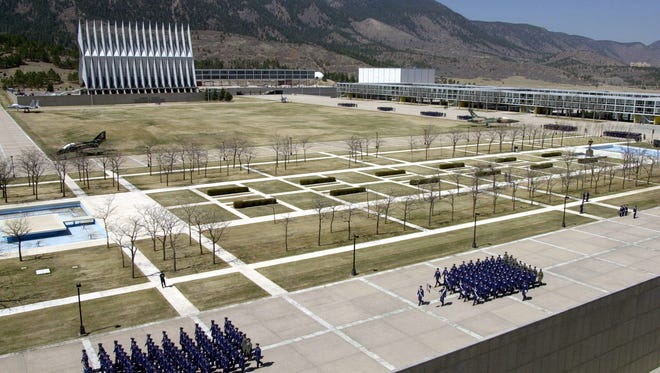This image taken in 2002 shows cadets marching in the center of the Air Force Academy campus in Colorado Springs, Colo.