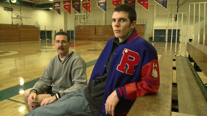 Interim Louisville basketball coach David Padgett, right, poses for a picture in the Reno Gazette-Journal with his dad, Pete, the longtime Reno High School basketball coach.