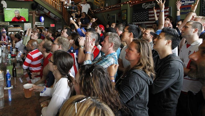 Inside the Nomad World Pub, fans cheer for Team USA during a Brady Street party to watch the Team USA vs. Portugal soccer match at the 2014 World Cup in Brazil.