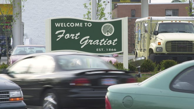 North River Road traffic buzzes past the welcome to Fort Gratiot sign west of Pine Grove Avenue.