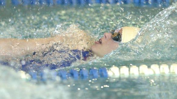 Montville's Lauren English swims the 100-yard backstroke