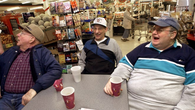 From left, George Hunt of Seven Valleys, Ray Wayland of Glen Rock and Keith Smith of Seven Valleys laugh and joke around during a morning meeting at Wetzel's Market in 2004. The market will close its doors in 2018.