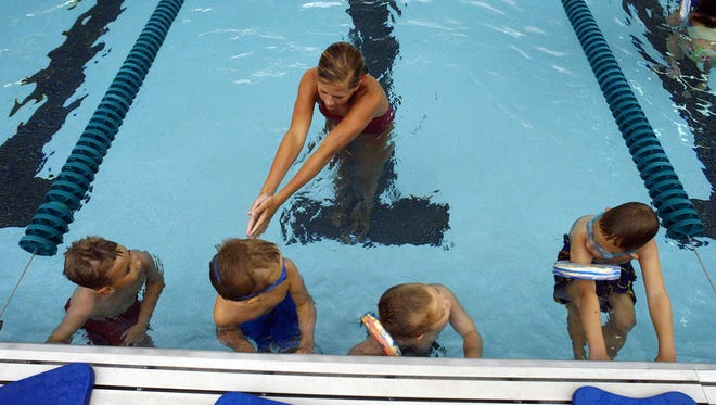 Brooke Thompson, 16, teaches the fundamentals of swimming at the Greenwood Community High School pool on June 28, 2006.