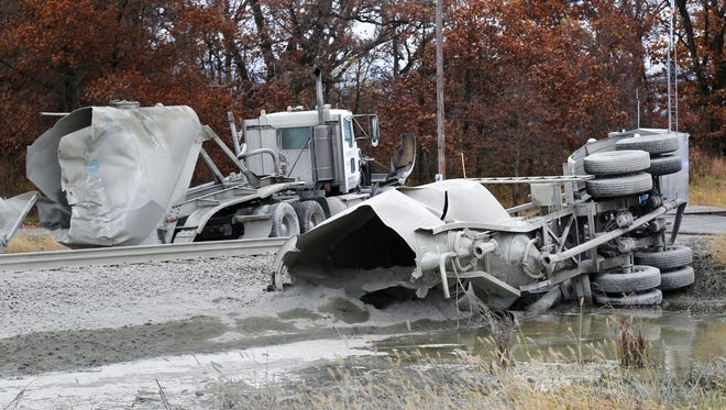 A semitrailer hauling cement lies in two pieces after an Amtrak train struck it about 8:30 a.m. on Oct.  28, 2014, in Reynolds, Ind.