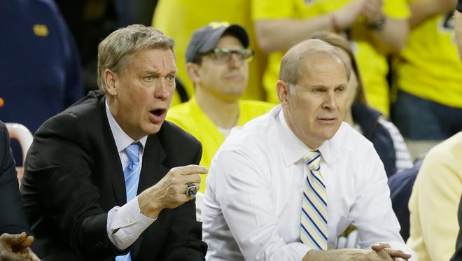 Michigan assistant coach Jeff Meyer, left, and head coach John Beilein on Jan. 10, 2015.
