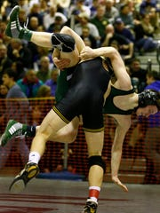 Kyle Bythell of South Plainfield is thrown to the mat by Austin Nash of Hanover Park in their 132 pound match during the quarterfinals of the Region III wrestling tournament at Union High School, Union, N.J. on Friday.