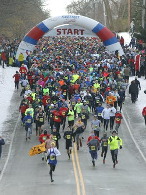 CARLOS ORTIZ/2013 file photo Start of the Webster Turkey Trot near Webster Park on Holt Road in Webster. Start of the Webster Turkey Trot near Webster Park on Holt Road in Webster, N.Y. on Thursday, November 28 2013. The course, mainly on the road and with the last 3/4 mile on trail in Webster Park, included distances of 4.4 and 2.5 miles.