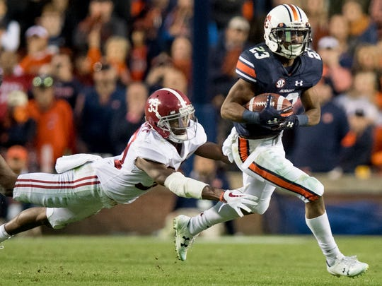 Auburn wide receiver Ryan Davis (23) eludesAlabama defensive back Levi Wallace (39) in the Iron Bowl in Auburn, Ala. on Saturday November 25, 2017. (Mickey Welsh / Montgomery Advertiser)