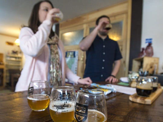 Erica Koeller and Brad Windsor of Shrewsbury, Massachusetts, sample a flight of beers at Foley Brothers Brewing in Brandon.