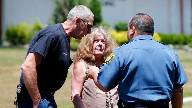 Charlene and Joseph Handrik speak with Monmouth County SPCA Lt. Tom Nuccio after their initial appearance in Howell Municipal Court Wednesday, June 29, 2016.  They faced hundreds of dog hoarding charges