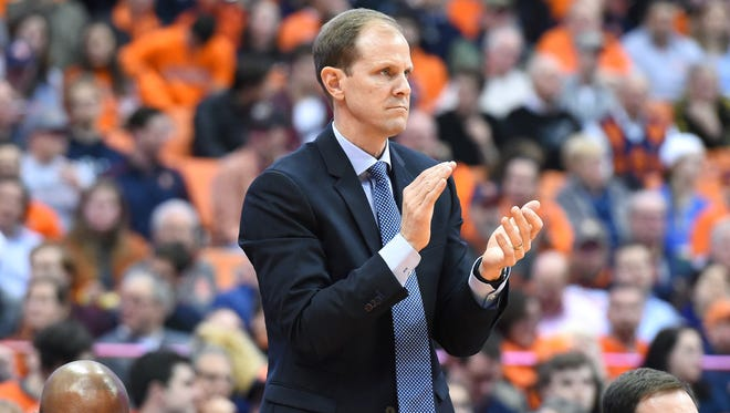 Syracuse Orange assistant men's basketball coach Mike Hopkins reacts to a play while serving as the interim head coach during Jim Boeheim's suspension.