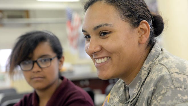 Rosa Santiago of Bridgeton, a U.S. Army National Guard specialist, smiles while surprising her daughter at the ExCEL school in Bridgeton.