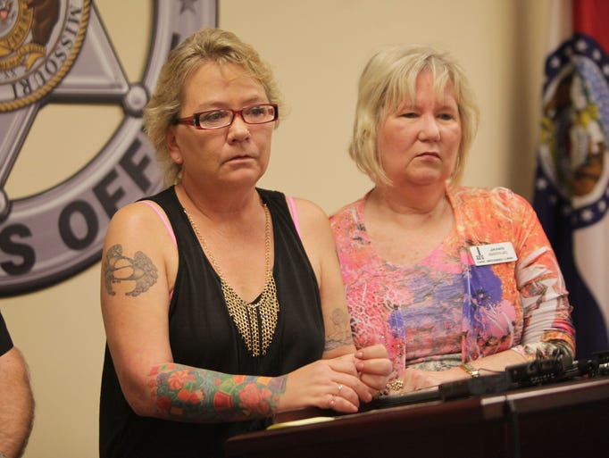 Suzette Martin, left, with Janis McCall, speaks a press conference on Thursday, April 3, 2014, about her 13-year-old daughter, Stephanie Mahaney, whose body was found in 1997 in a farm pond west of Springfield.