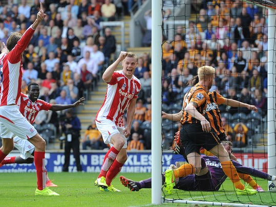 Stoke City's Ryan Shawcross, centre, jubilates after scoring his teams first goal against Hull City, during their English Premier League match at the KC Stadium, Hull, England, Sunday Aug, 24, 2014. (AP Photo/PA, Martin Rickett)   UNITED KINGDOM OUT  NO SALES  NO ARCHIVE