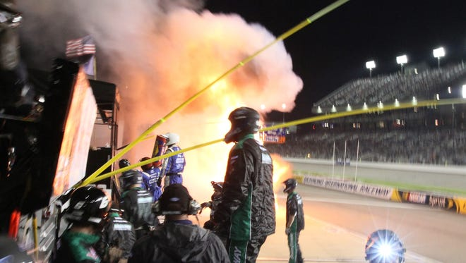 A fire burns on pit road during the the NASCAR Xfinity auto race at Richmond International Raceway.