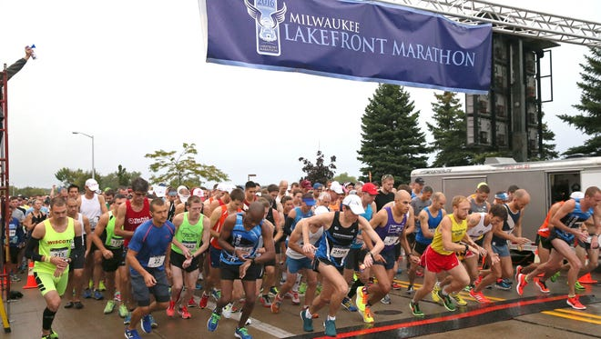 Runners cross the starting line in Grafton during the Milwaukee Lakefront Marathon in 2016.