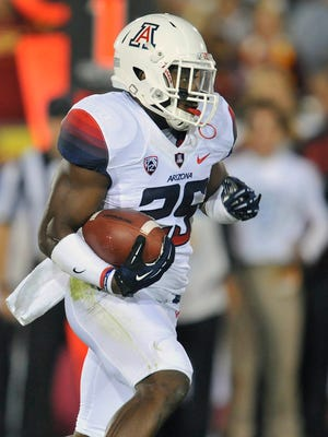 Arizona Wildcats running back Ka'Deem Carey (25) runs the ball against the Southern California Trojans during the first half at the Los Angeles Memorial Coliseum.