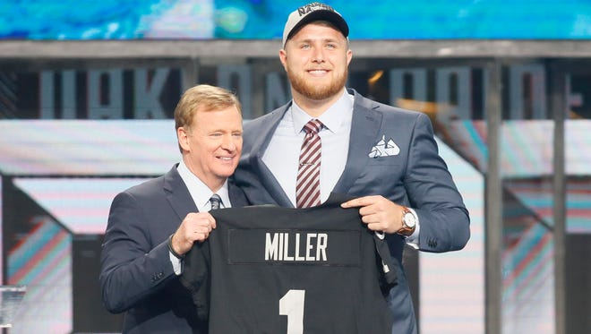 Kolton Miller (UCLA) with NFL commissioner Roger Goodell after being selected as the number fifteen overall pick by Oakland in the first round of the 2018 NFL Draft