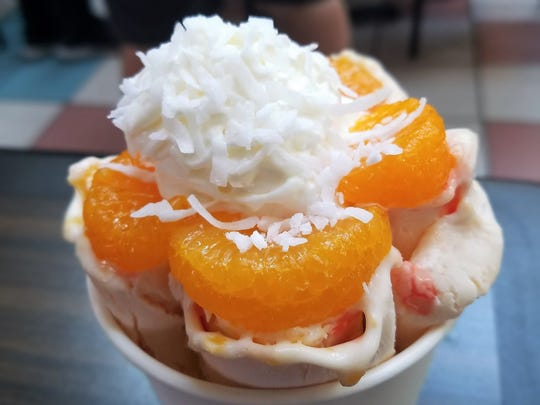 "The ""Follow your Heart,"" with peach ice cream, mandarine oranges, peach and strawberry syrup, coconut and whipped cream."