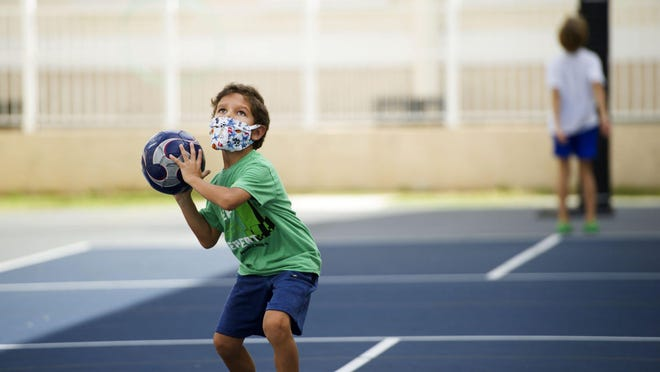 Max Principe, 6, throws a soccer ball during Mad Science summer workshop for children ages 5 though 12 at The Morton and Barbara Mandel Recreation Center Wednesday July 8, 2020 in Palm Beach.