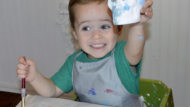 Clay Cafe painter, Carson Feehan, 3, used his creative imagination Thursday morning to paint his ceramic skull.