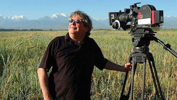 Jim Dollarhide sets up his camera in a field used to