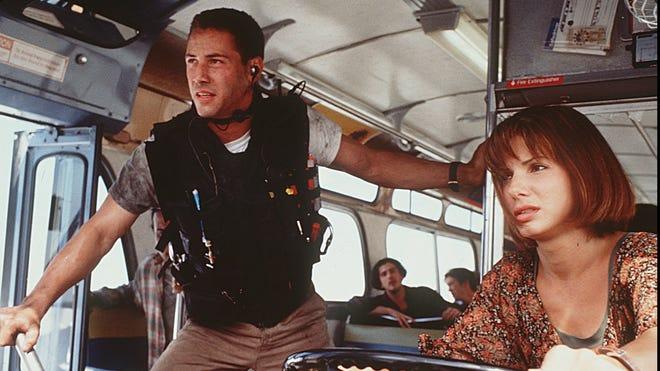 Keanu Reeves co-stars with Sandra Bullock in 'Speed.'