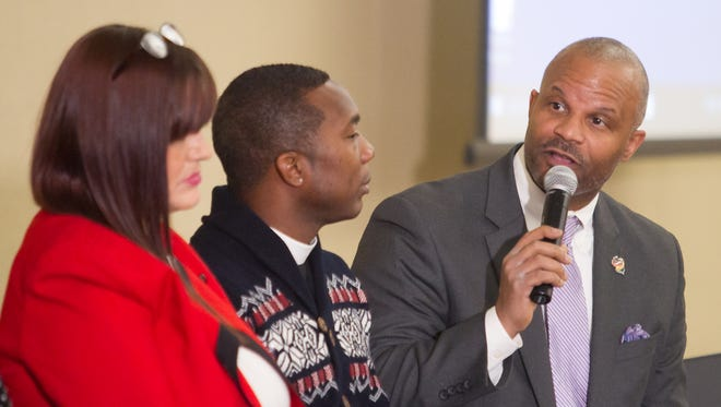 Panel moderator Anthony Lewis, director of business and community affairs for the Michigan Department of Civil Rights, right, directs topics pertaining to mass incarceration at a luncheon held at Cleary University Monday, Jan. 15, 2018 for Martin Luther King Jr. Day. Listening at left are former inmate Robin McArdle and the Rev. Deon Johnson, board member of the Livingston Diversity Council.