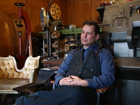 Mark Nelson at his shoe maker's shop in the City of
