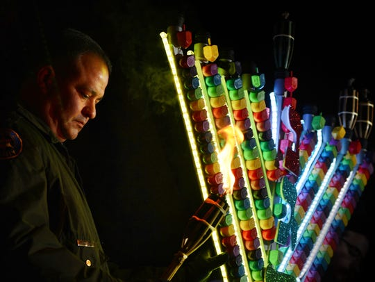 A Hanukkah celebration in Newbury Park this weekend will include the lighting of a giant glow-in-the-dark menorah, a performance by Fantastic Patrick, music, crafts, latkes and doughnuts.