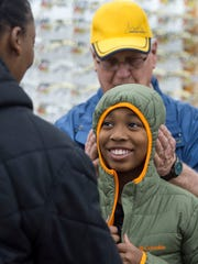 Stephen Calmes, 11, tries on a jacket donated by Columbia Sportswear during the Fraternal Order of Police Lodge No. 9 Cops and Kids event at Walmart in Henderson, Ky., on Wednesday, Dec. 13, 2017. This year, about 60 children in need shopped with an officer for clothes, toiletries, and other items, with money raised by the Fraternal Order of Police Lodge No. 9.