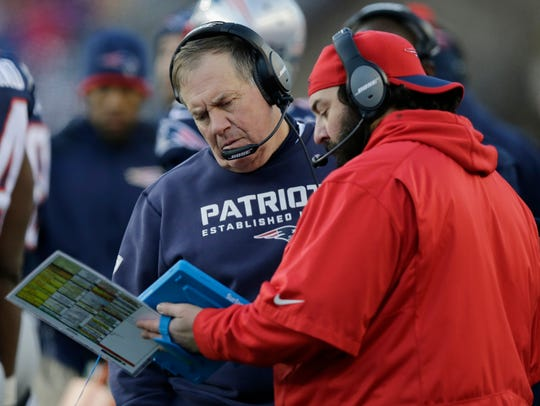 Patriots head coach Bill Belichick, left, and defensive