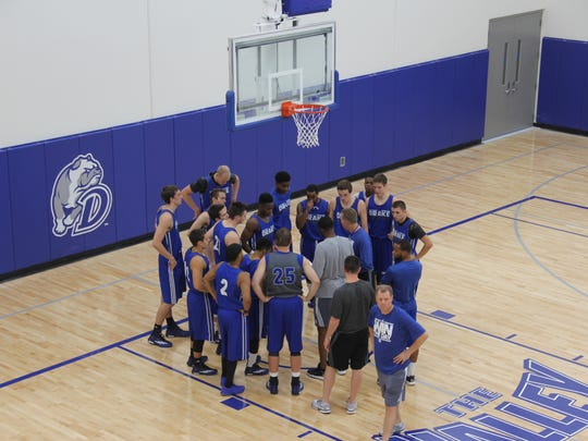 The Drake basketball team practices at its new facility.