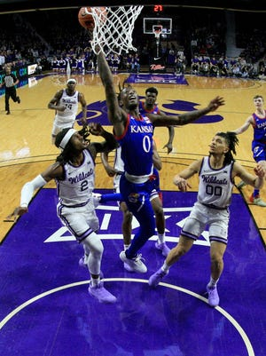 Kansas basketball's Marcus Garrett, middle, was one of six players named a preseason All-Big 12 first team selection Wednesday.