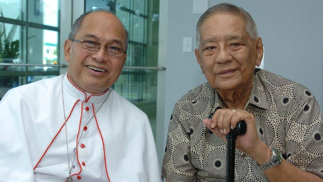 "In this file photo, Archbishop Anthony Apuron, left, sits with Pedro ""Pete"" Ada Jr."