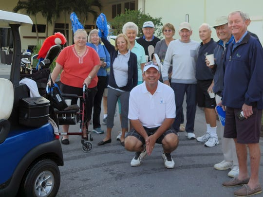 Bentley Village pro Stan Geer, center, poses with residents who served as his caddies during a 180-hole marathon to support the Harry Chapin Food Bank on Monday, Dec. 4, 2017.