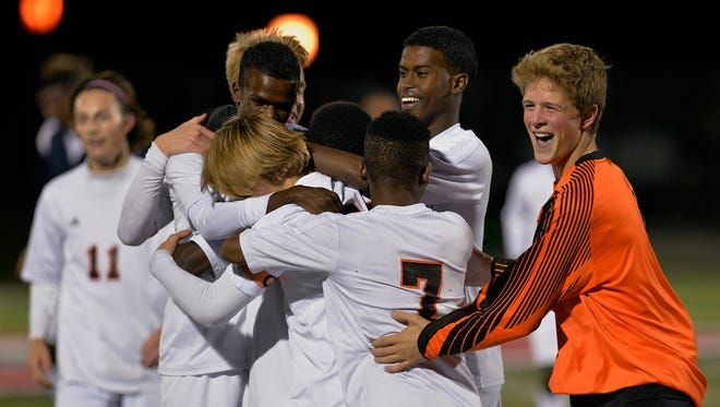 St. Cloud Tech players celebrate their 3-1 win over Rogers in their Sect. 8-2A soccer championship Tuesday night, Oct. 20 at Husky Stadium.