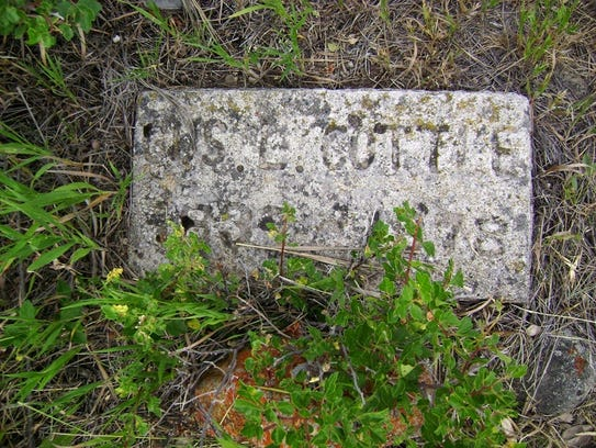 A few tombstones like this one of Gus Cottle, one of