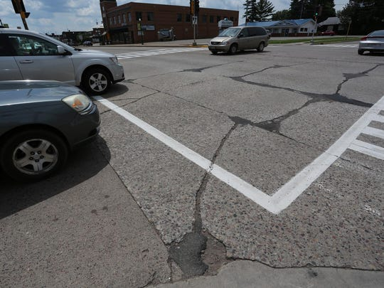 Cars cross North Central Avenue at Arnold Street in Marshfield, Wednesday, June 24, 2015