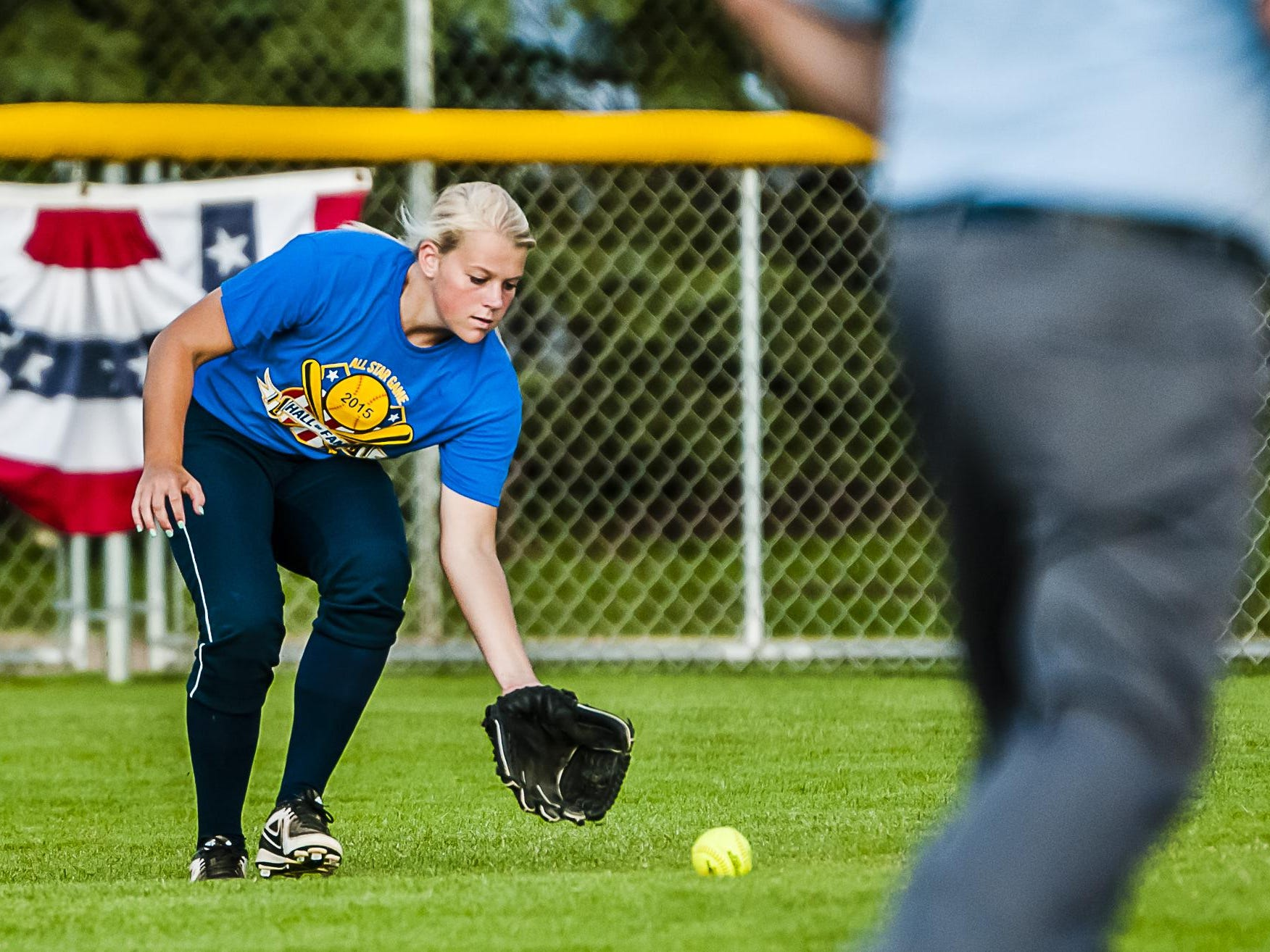 Lauren Hazel of the West team charges an East team drive to right field during their All-Star game Friday July 10, 2015 at Ranney Park in Lansing. KEVIN W. FOWLER PHOTO