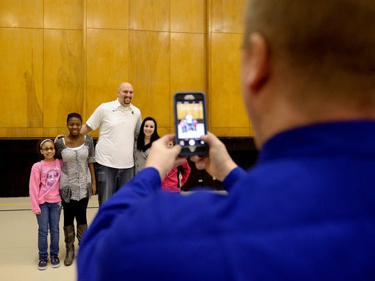Former Spartan Anthony Ianni stands with students at Concord Middle School as principal Matt Lehman takes their photo on Feb. 4.