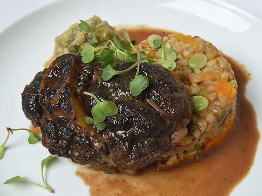 """Native American ingredients inspired this sage-rubbed bison osso buco with barley and """"three sisters"""" risotto (favas, butternut squash, roasted corn) from chef Auriane Ugalde of the Bridge."""