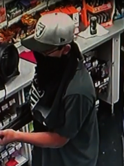 Security footage of an alleged armed robber in an Indio Circle K on May 26.
