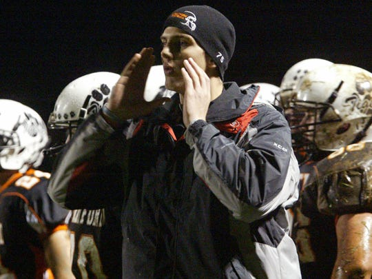 In this 2007 file photo, Stratford's Jordan Bauman sideline coaches his teammate during a game against Auburndale.